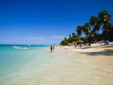 Tourists Walking Along El Cortecito Beach