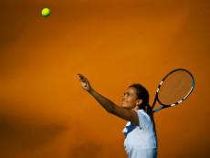 Female tennis player getting ready to serve, Wimbledon, London, United Kingdom