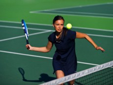 Female tennis player in motion, Wimbledon, London, United Kingdom