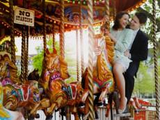 Couple on carousel, London, England, UK