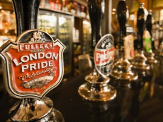 Close-up of beer pump clips in London pub