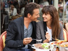 Couple enjoying lunch at a restaurant, Paris, Ile-de-France, France