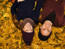 Young couple lying in autumn leaves