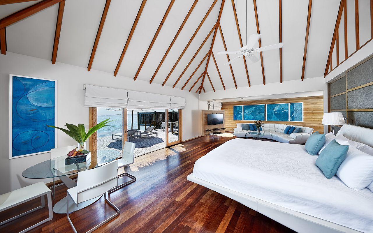 CONRAD MALDIVES_Premier Water Villa_bedroom_architectural_credit Justin Nicholas - hi-res