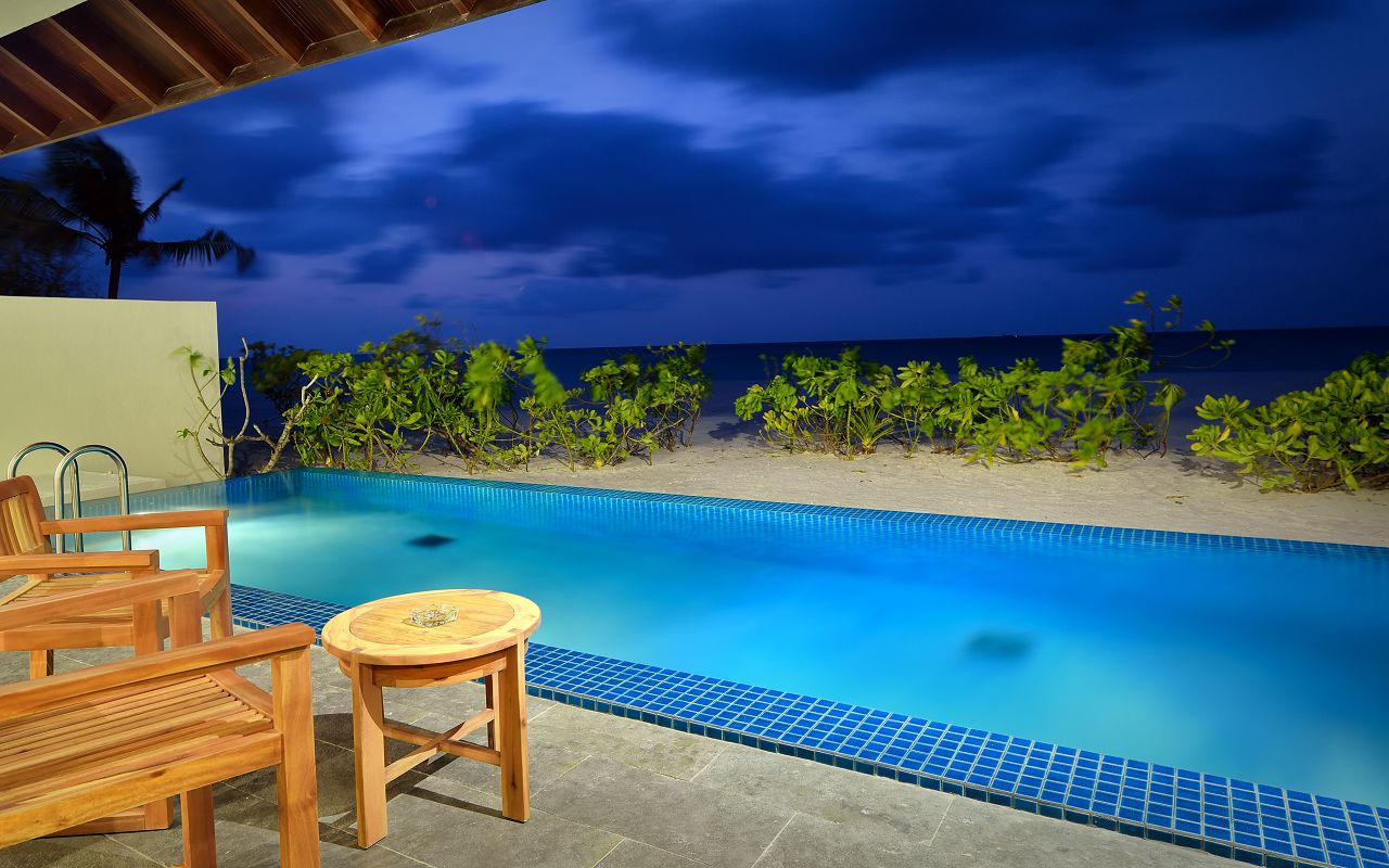 SUNSET POOL VILLA - EXTERIOR AT DUSK WITH VIEW-min
