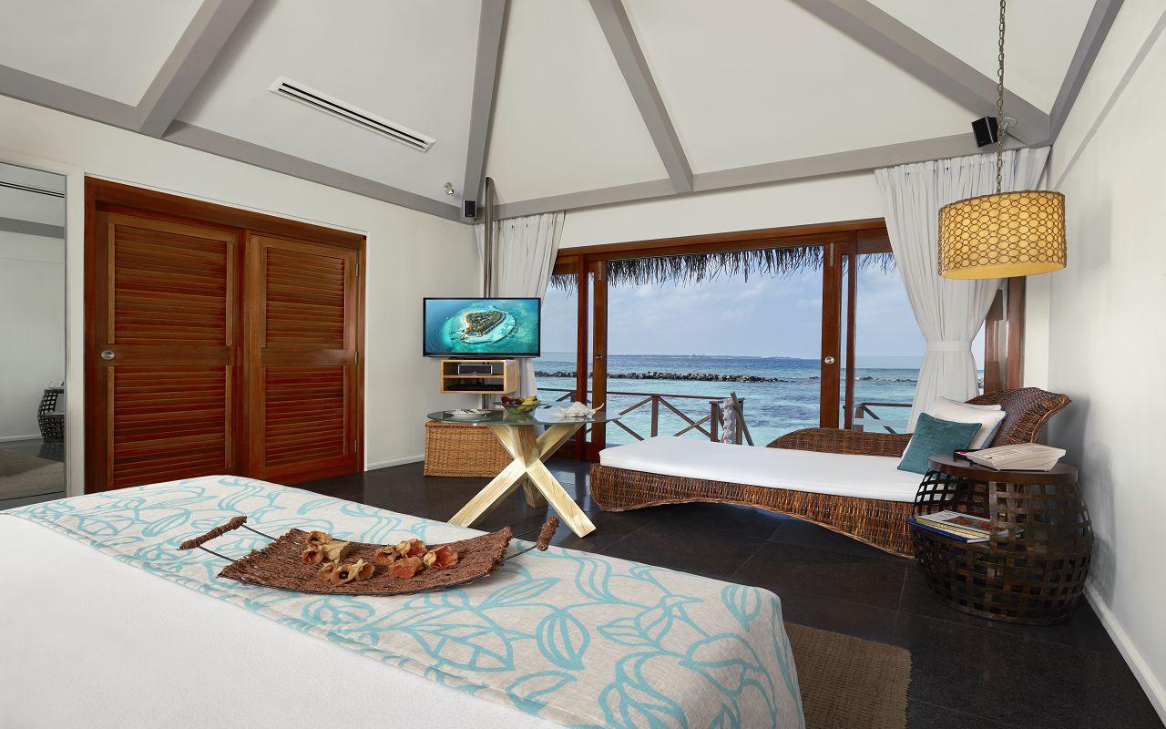 Taj Coral Reef Resort and Spa_Premium Water Villa-Bedroom(1)