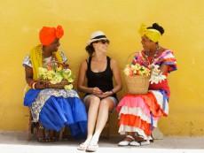 Tourists with Flower Ladies. Havana. Cuba.