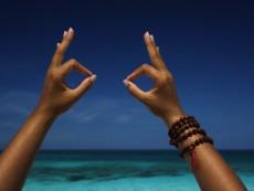 Close up of hands making gesture on beach, Paradise Island, Nassau, Bahamas