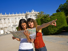 Tourists Looking at Map in Front of Royal Palace