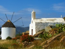 View of windmill and church, Chora, Ios, Cyclades, Greece