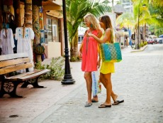 Two women shopping in seaside town