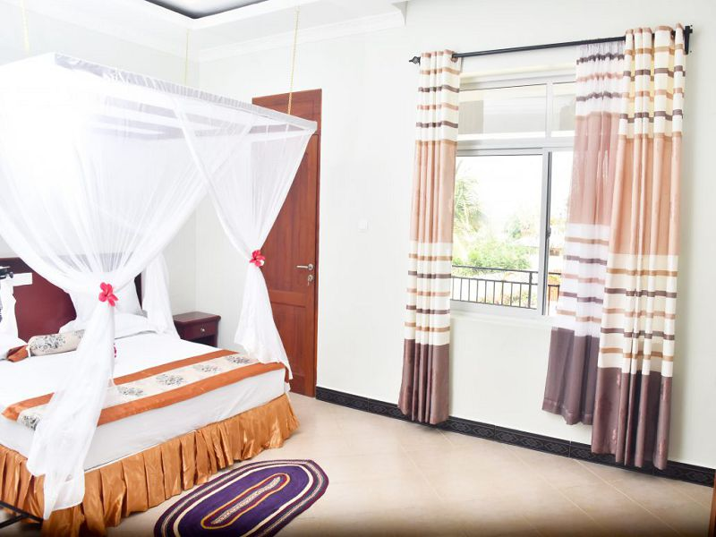 Junior-suite-Room-with-private-balcony_village-view-1-1030x687