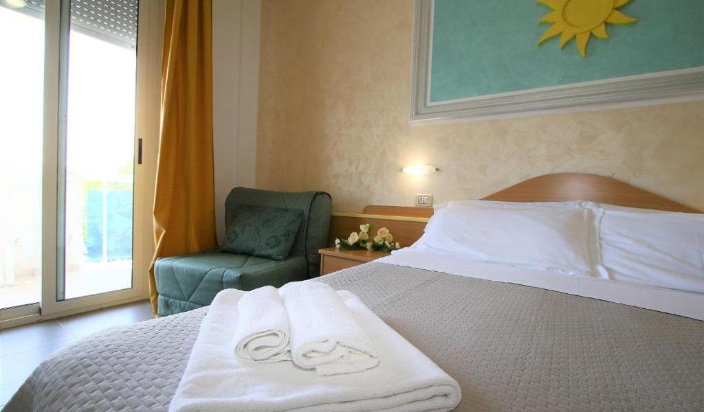 Quadruple-Room-with-Balcony-min