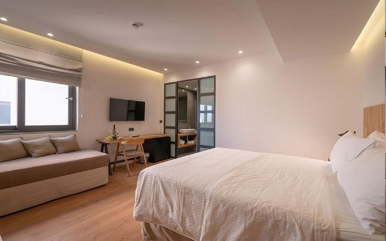Glow Boutique Triple Room with Side Sea View-1
